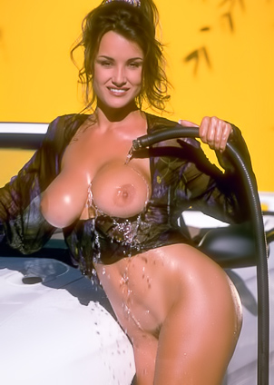 Naked Lisa Ann washes her posh car